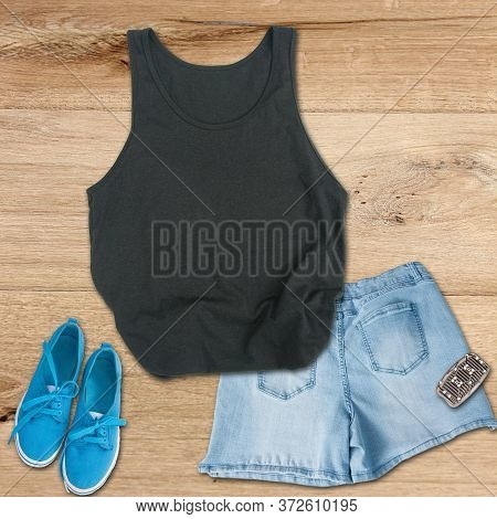 Black Tank Top Mockup With Jean Shorts, Blue Canvas Sneakers And A Hair Clip On A Wood Floor For Sum