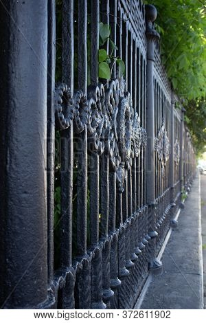 Fragment Of Old Wrought Iron Fence Isolated.