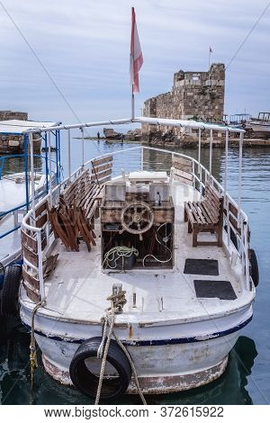 Boat In A Marina Of Byblos, Lebanon, One Of The Oldest City In The World, View With Ancient Ruins On