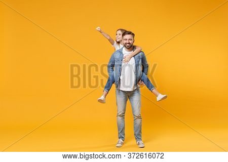 Smiling Bearded Man With Child Baby Girl. Father Little Kid Daughter Isolated On Yellow Background.