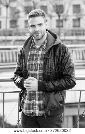 Waiting For You. Just Relaxing Here. Man Wearing Leather Jacket. Street Style. Portrait Guy Outdoors