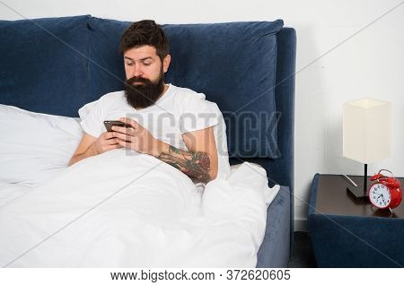 Checking Social Networks Up. Bearded Man Read Sms In Bed. Modern Life. Modern Technology. Internet S