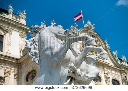 Vienna, Austria - August 27, 2019. Horse Statue On The Background Of The Belvedere Palace In Vienna