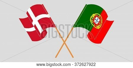Crossed And Waving Flags Of Portugal And Denmark. Vector Illustration