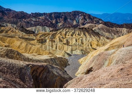 Magnificent landscape and a variety of shades. Picturesque multicolor sunset. Zabriskie Point in Death Valley, California, USA. The concept of active, extreme and photo tourism