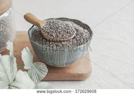 Black Chia Seeds In Wooden Spoon And Bowl, Superfood Healthy Fiber Food For Gut Health