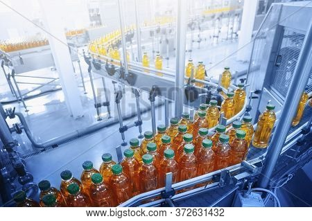 Beverage Factory, Conveyor Belt With Juice In Bottles, Industrial Interior In Blue Color, Food And D