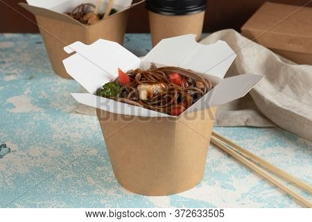Eco packaging - potato wedges in craft packaging for delivery service. Vegan food.