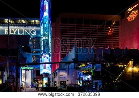 Las Vegas, Nevada, Usa - February 20, 2020: Illuminated Neon Lights Of The Las Vegas Strip With Stre