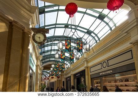 Las Vegas, Nevada, Usa - February 20, 2020: Shoppers Stroll The Promenade Past The Luxury Retail Sto