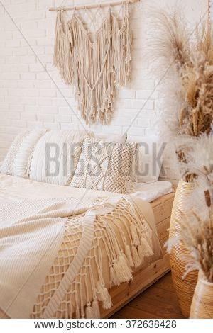 Bright Boho Style Bedroom With Macrame Decor.
