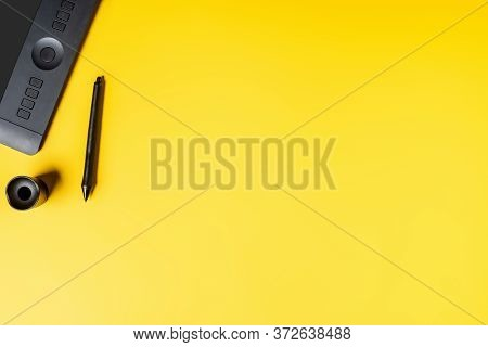Top View Of Stylus Holder And Drawing Tablet Near Stylus On Yellow