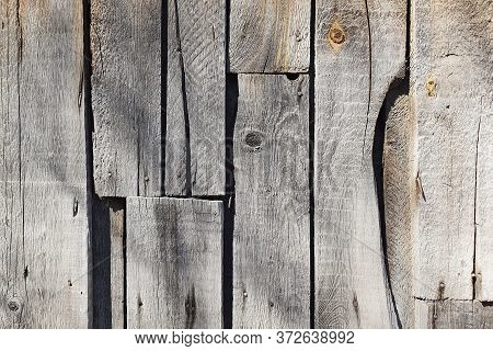 Old Rustic Wall Made Of Rough Boards.