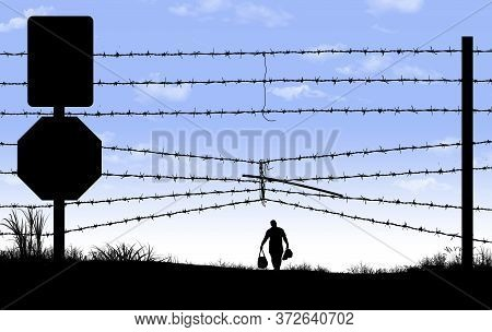 A Man Is Seen In Silhouette After Breaching A Border Fence On The Southern Border Of The Usa.