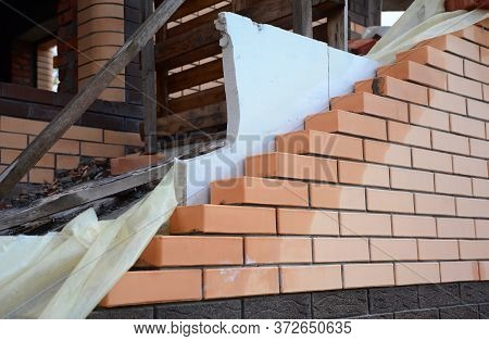 A Close-up On A Wet Brick Wall Under Construction With Thermal Insulation System Using Styrofoam, Po