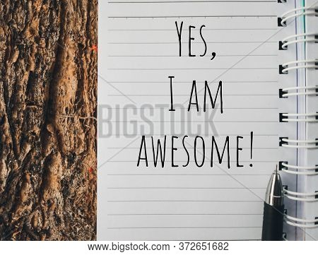 Motivational And Inspirational Quote - Yes, I Am Awesome Text Written On Notepaper. Stock Photo.