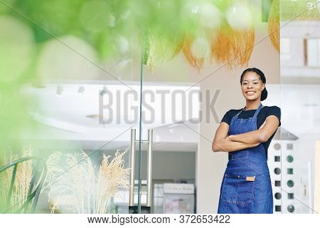 Portrait Of Happy Beautiful Young Black Woman Just Started Bakery Business And Opened Fist Shop