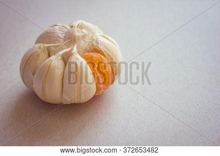 Large Garlic Onion With One Orange Slice Of Mandarin. Strange Person, Not Like The Others, Odd Man O