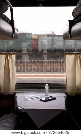 Interior Of A Long-distance Train In Russia. Window In The Train Compartment. Sanitizer, Mask And Ph