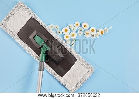 A Mop For Home Cleaning And A Flower-scented Wash On Blue Background. Concept Of Natural Eco-friendl