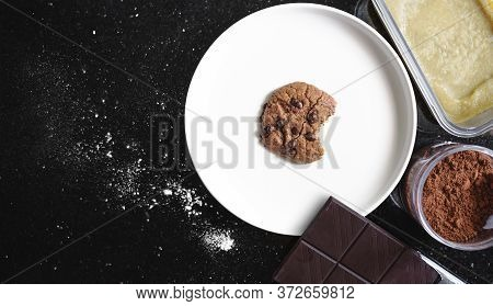 Bitten Chocolate Chip Cookie On White Plate, With Ingredient