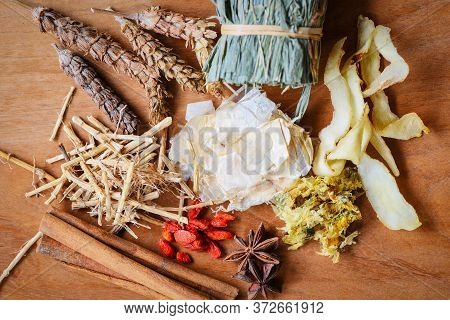 Herbal Medicine Dried Herb From Nature Non-toxic Organic Product On Wooden Background / Dry Spices A