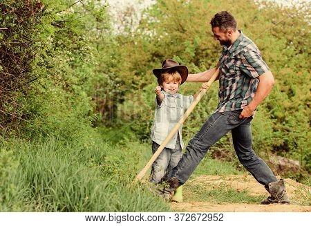 Little Boy And Father In Nature Background. Spirit Of Adventures. Little Helper In Garden. Child Hav