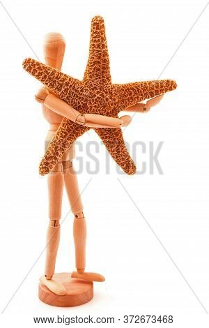 Concept With Sea Star, Seastar And Standing Wooden Toy. Isolated On White Background.