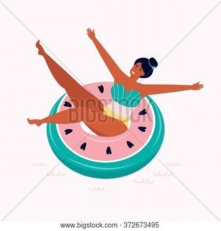 Happy Woman In A Swimsuit Rests On An Inflatable Watermelon Float In The Pool. Toy For Swimming In T