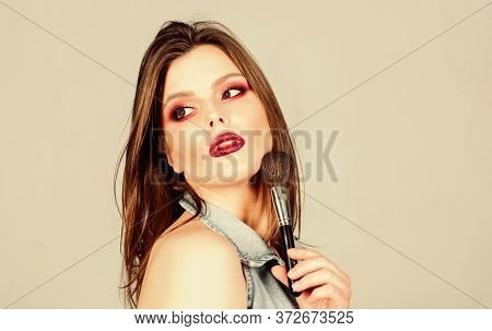 Facial Care. Sexuality. Skincare Cosmetics. Sexy Woman With Professional Make Up Brush. Fashion Make