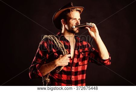 Sheriff Concept. Brutal Cowboy Drinking Alcohol. Western Culture. Western Life. Man Wearing Hat Hold