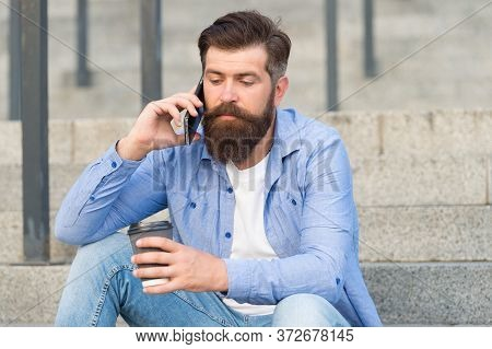 Mobile Life. Hipster Drink Coffee Talking On Mobile Phone Outdoors. Mobile Communication. Hot Cup. T