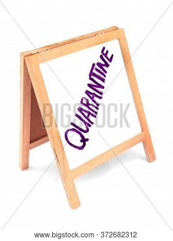 Coronavirus Concept With Text Quarantine, Announcement On Wooden White Board, Blackboard, Chalkboard