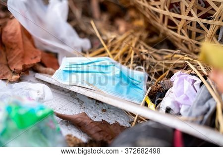Used Face Mask Discard In Household Garbage. Medical Waste Disposal With Unhygienic Management. Cont