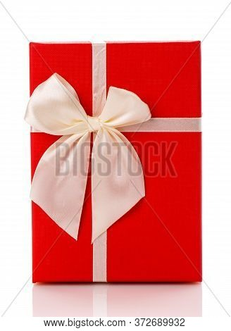 Red Gift Box With White Ribbon Bow Isolated On White Background. Top View.