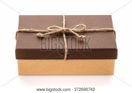 Brown Gift Box With Linen Ribbon On A White Background. Gift For Her Husband. Gift For Any Holiday.