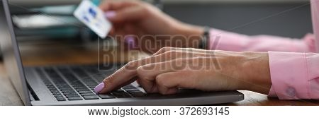 Hands Hold Credit Card And Enter Info Into Laptop. Deposit And Accumulation On Card. Order Goods And