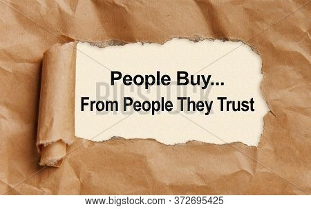 Text People Buy From People They Trust, Appearing From Tattered Craft Paper