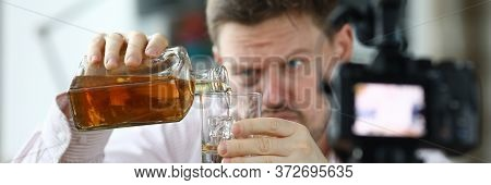 Shabby Man Front Camera And Pours Himself Whiskey. Rowdy Promotes Drunkenness. Person Is Addicted To