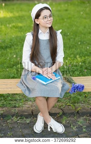 More Than Fashion. Little Child Relax On Park Bench In Uniform. School Fashion. Fashion Look Of Smal
