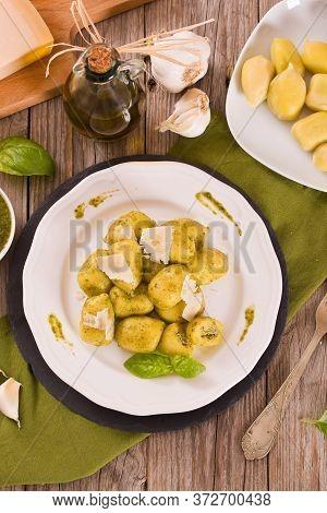 Potato Gnocchi Stuffed With Pesto Sauce On White Dish.