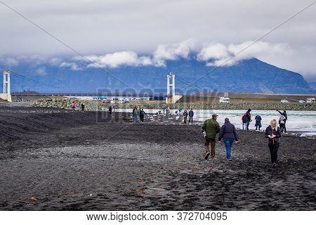 Eastern Region, Iceland - June 12, 2018: Tourists Walks On On So Called Diamond Beach On The Atlanti