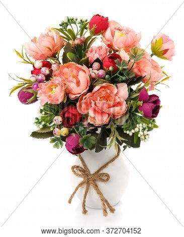 Bouquet Of Blooming Pink Flowers In White Vase With Burlap Bow. Isolated On White Background.