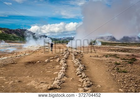 Hverir, Iceland - June 19, 2018: Hverir Geothermal Area With Boiling Mudpools And Steaming Fumaroles