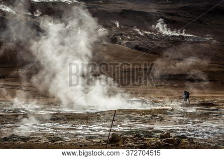 Hverir, Iceland - June 19, 2018: Landscape Of Hverir Geothermal Area With Boiling Mudpools And Steam