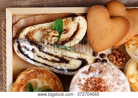 Apple And Poppy Strudel, Cookies And Fragrant Cinnamon Coffee On A Rustic Wooden Tray. Top View, Clo