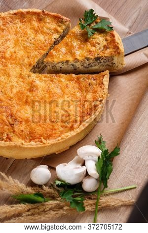 Traditional Vegetable Pie On Rustic Wooden Table. Sliced Slice Of Pie Stuffed With Mushrooms And Che