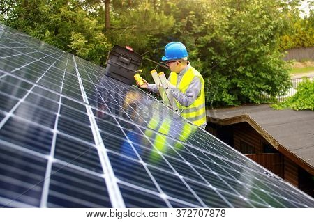 Photovoltaic Business. Solar Panels Installation And Commissioning. Renewable Green Energy In A Priv