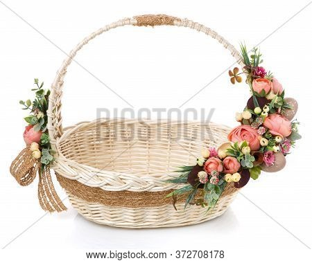Very Beautiful Original Wicker Basket Decorated With Pink Roses And Greenery. Around The Basket Is A