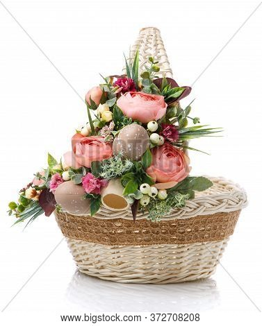 Wicker Design Baskets Are Decorated With A Floral Arrangement For Easter. On A White Background.